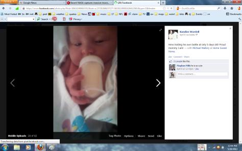 5 days old holding own bottle